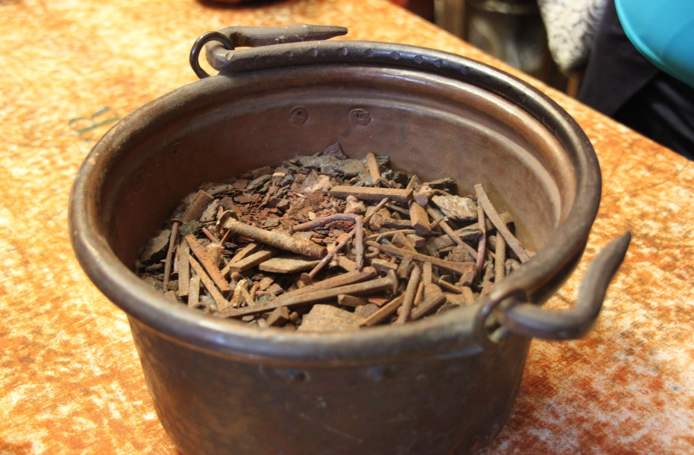 A bucket of rusty old nails gives a wonderful ochre colour to the natural inks used by the Antica Stamperia Artigiana Marchi in Santarcangelo di Romagna