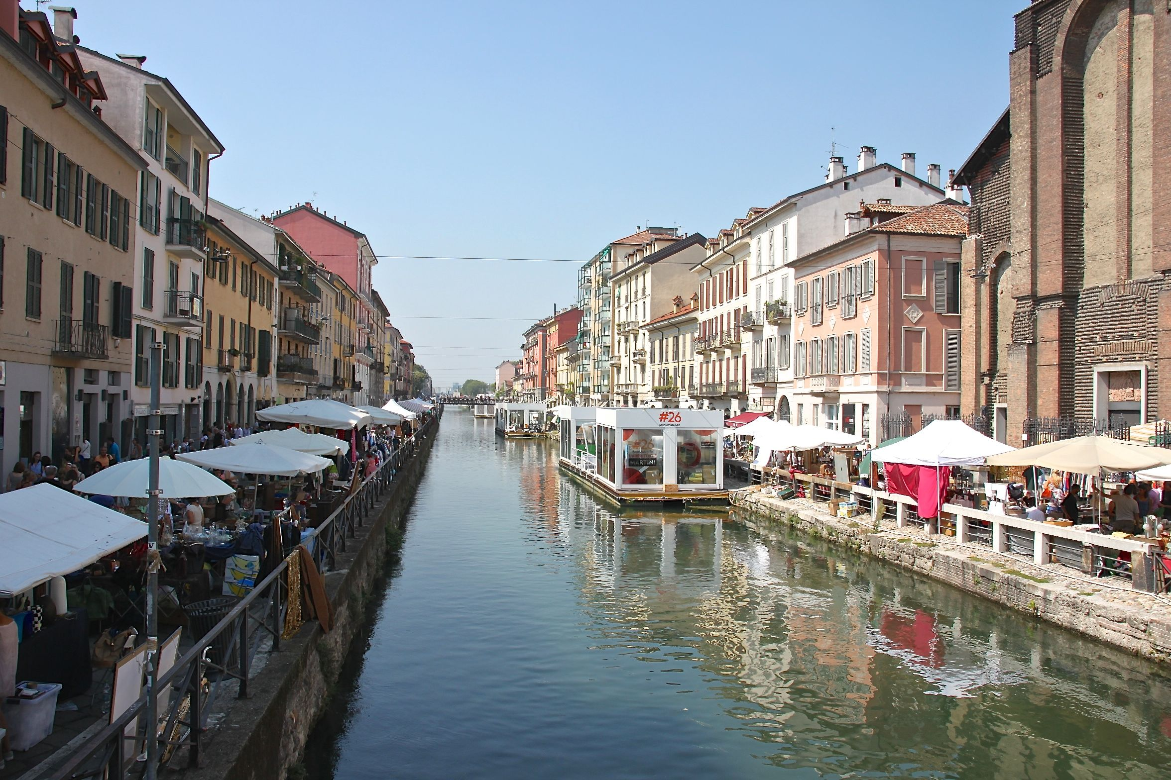 Stalls for Milan's Mercatone dell'Antiquariato line up along the banks of the Naviglio Grande canal