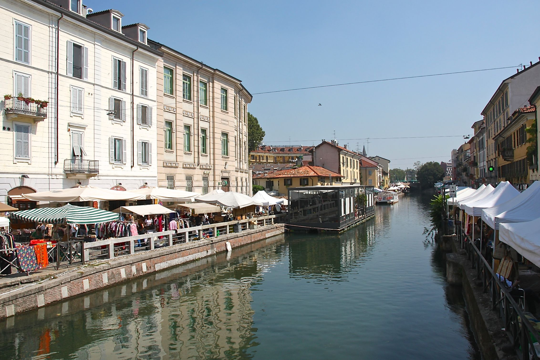 Antiques and collectibles stalls line 2km of the banks of the Naviglio Grande canal in Milan