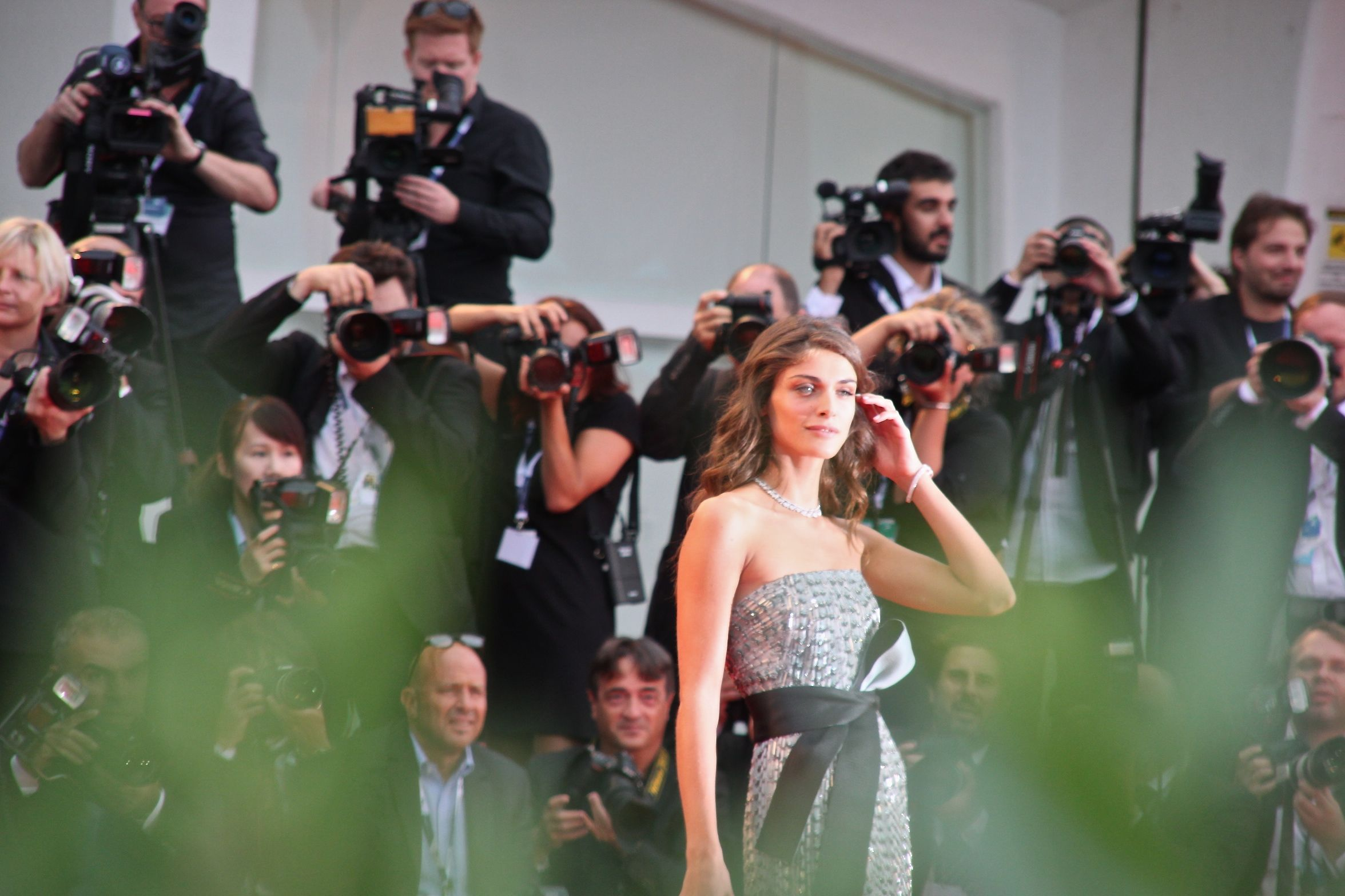 Venice Film Festival's madrina Elisa Sednaoui wows in a full-length silver dress