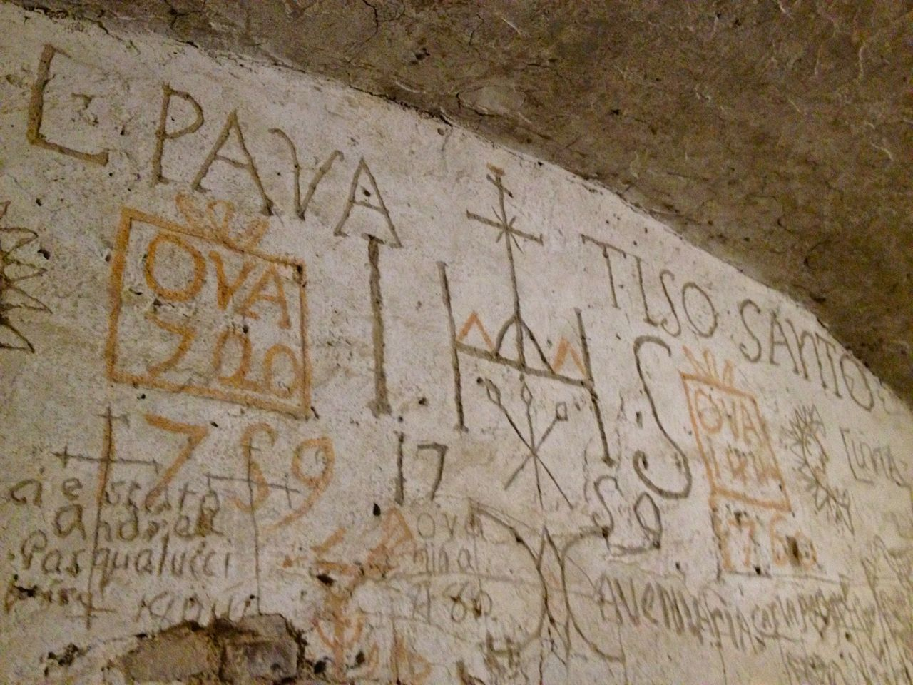 Giuseppe Andrea Lombardini's graffiti scratched into the prison cell walls includes written codes and masonic symbology