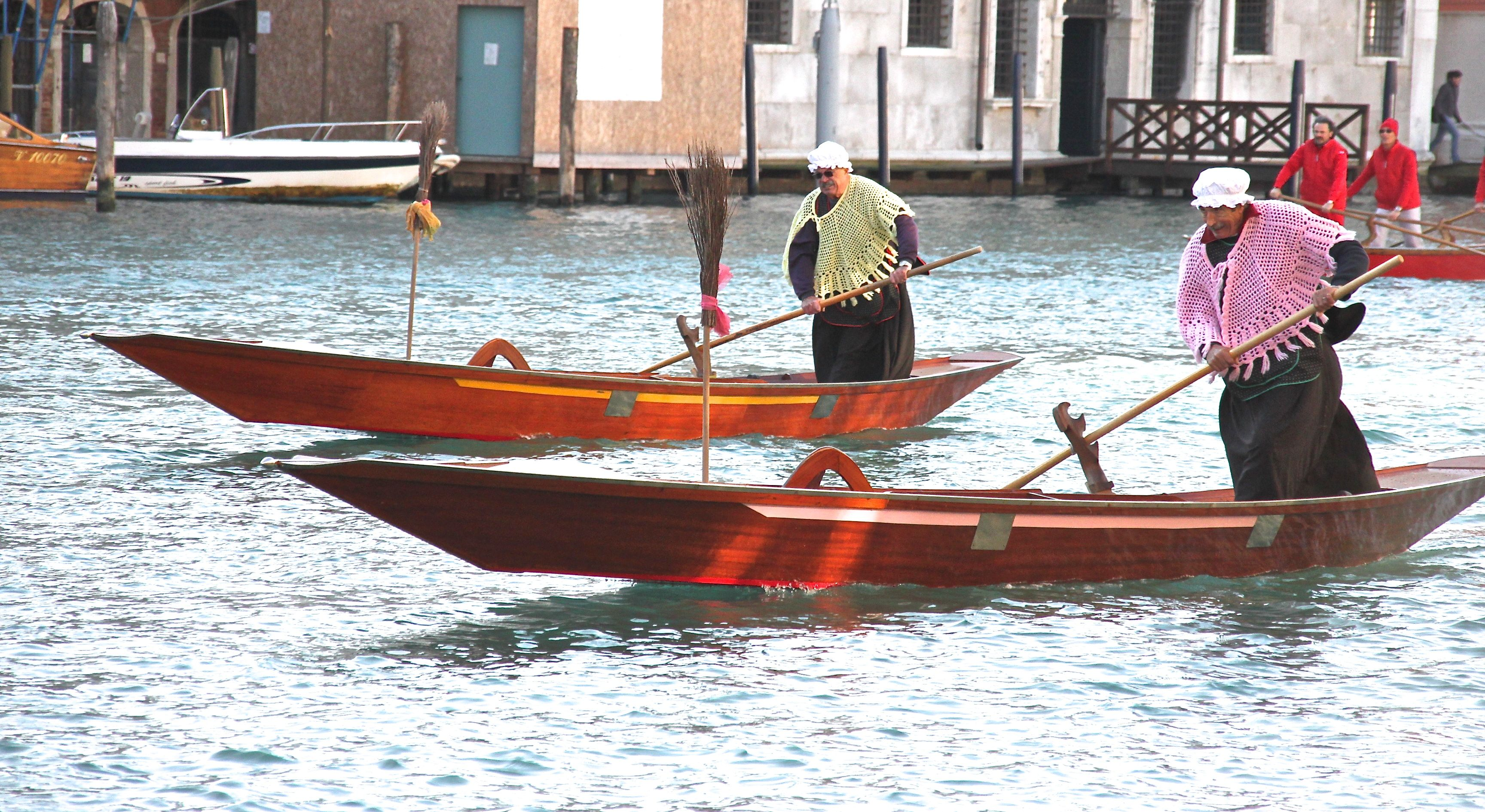 Retired Venetian rowers and gondoliers race along the Grand Canal dressed as La Befana