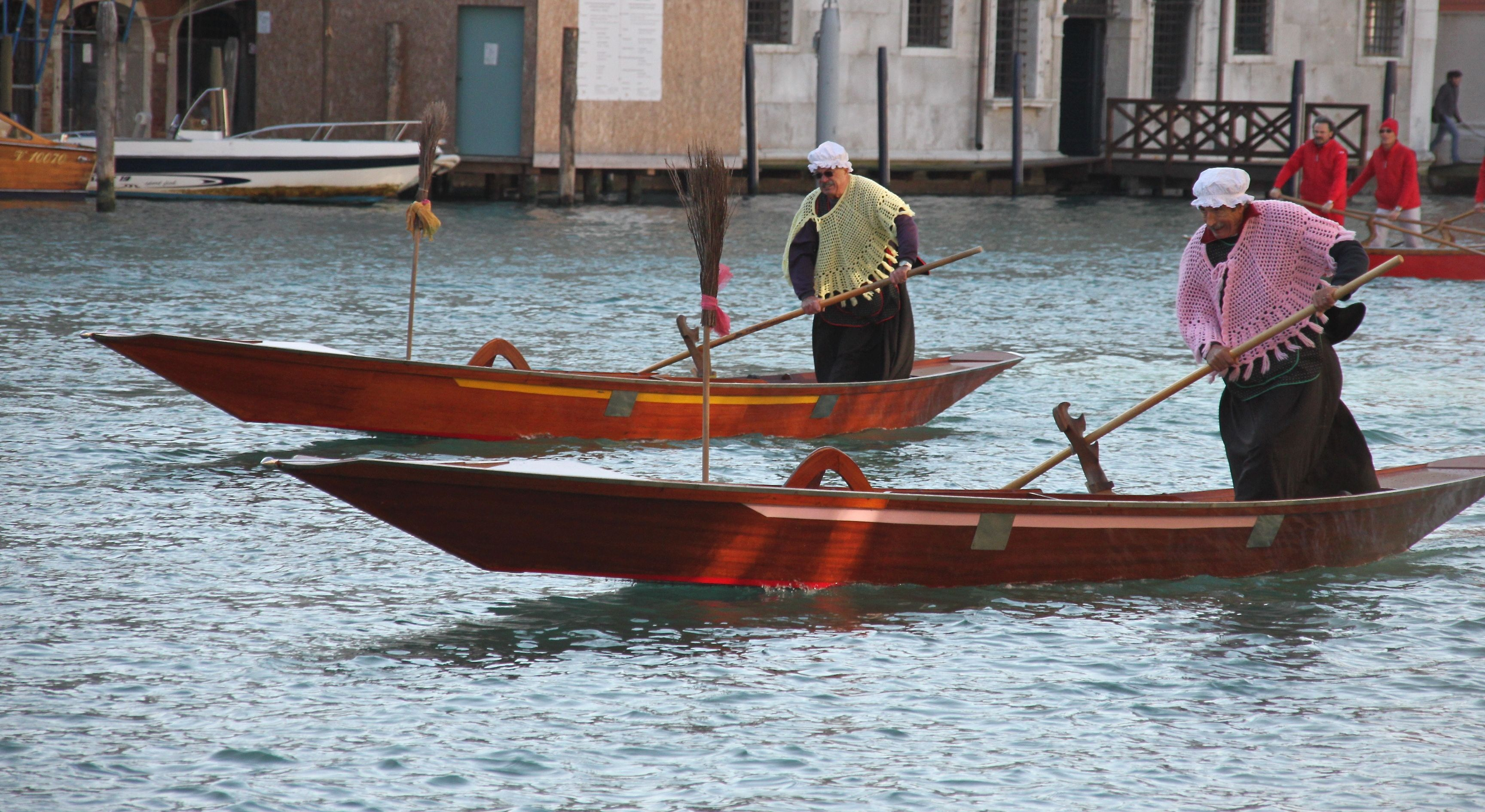 Gondoliers dress as La Befana and race down the Grand Canal in Venice on January 6th to celebrate Epiphany