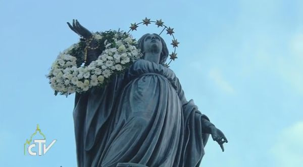 The statue of the Madonna in Piazza Spagna is garlanded in flowers by the Pope