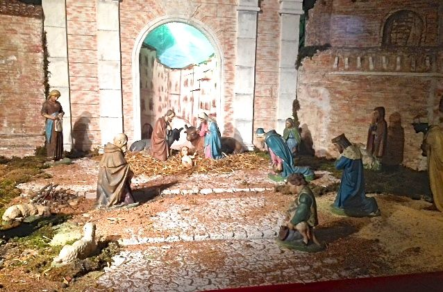 A hand made nativity scene, or presepe, in a shop window in Forlì, Umbria